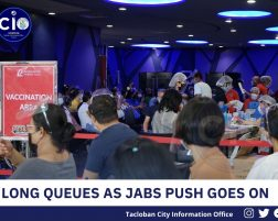 LONG QUEUES AS JABS PUSH GOES ON